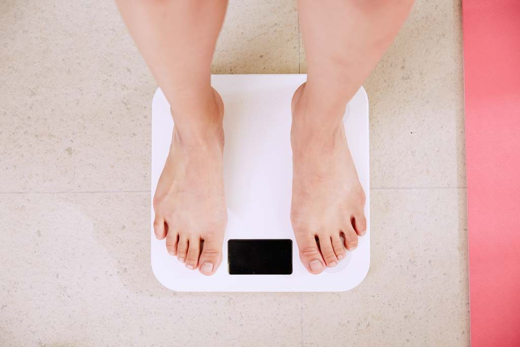 Feet standing on weighing Scales