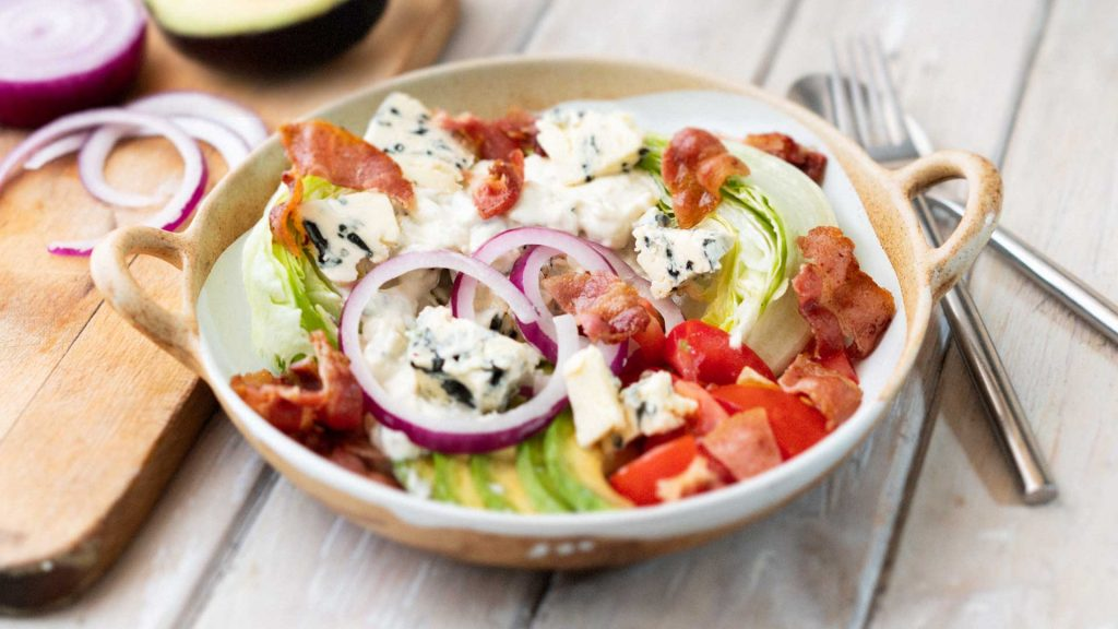 iceberg lettuce salad with blue cheese dressing tomatoes and crispy bacon