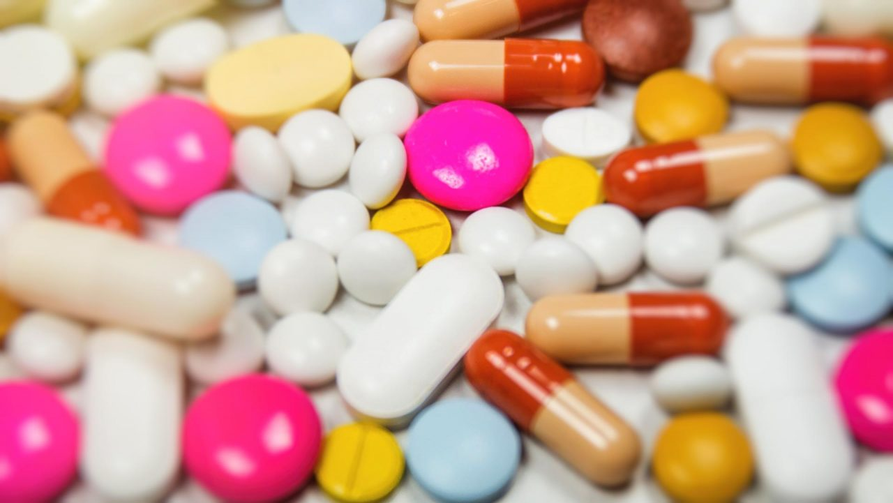 Pharmaceutical Drugs and tablets spread over a table