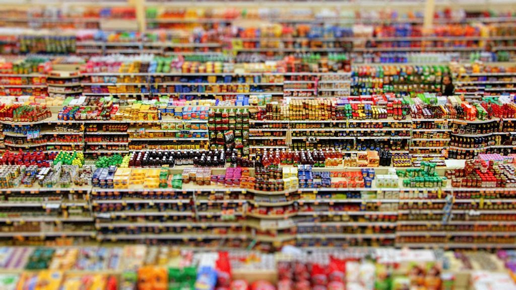 High Vantage View of Supermarket Produce that is processed, brightly coloured packs